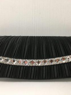 Zwart frons feesttasje met vierkante stenen